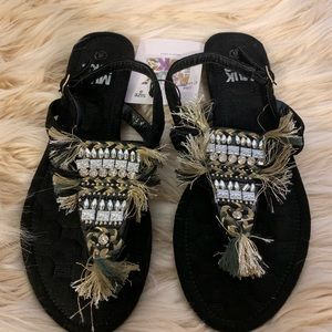 Mukluks camo inspired embellished thong sandals
